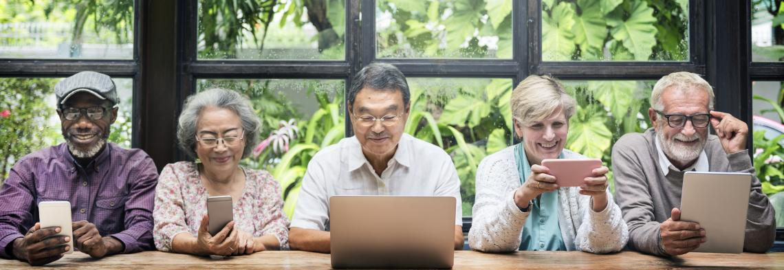 group of school retirees' using computers